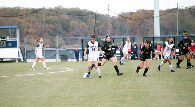 Army (black) and Navy (white) compete in the 2019 Patriot League women's soccer tournament in Annapolis, Md. PHOTO PROVIDED/Navy Athletics