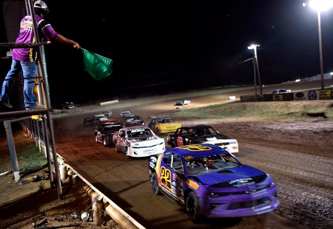 Stock cars are given the green flag to race Saturday at Abilene Speedway.