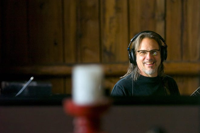 Gordon Stone listens to the playback tape after recording with his group in 2009 at The Barn in Westford, known to many as the Phish recording space.