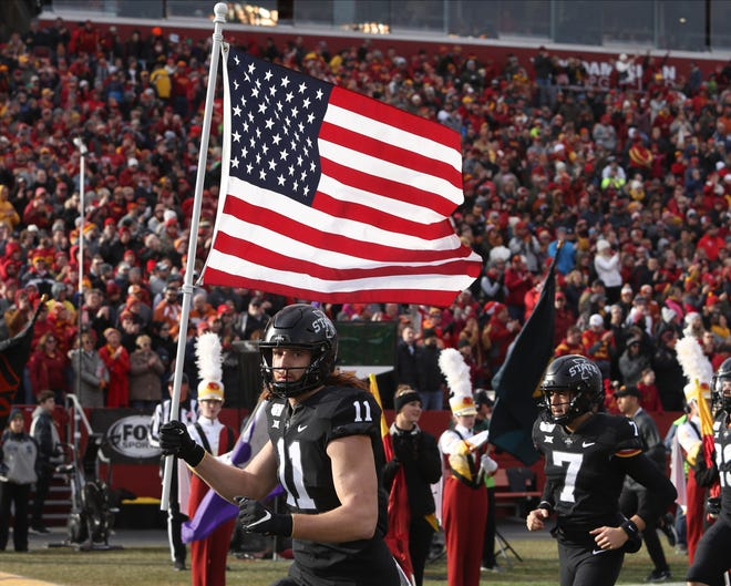 Nov 16, 2019; Ames, IA, USA; Iowa State Cyclones tight end Chase Allen (11) carries the American Flag on to the field before their game with the Texas Longhorns at Jack Trice Stadium. The Cyclones beat the Longhorns 23 to 21.  Mandatory Credit: Reese Strickland-USA TODAY Sports