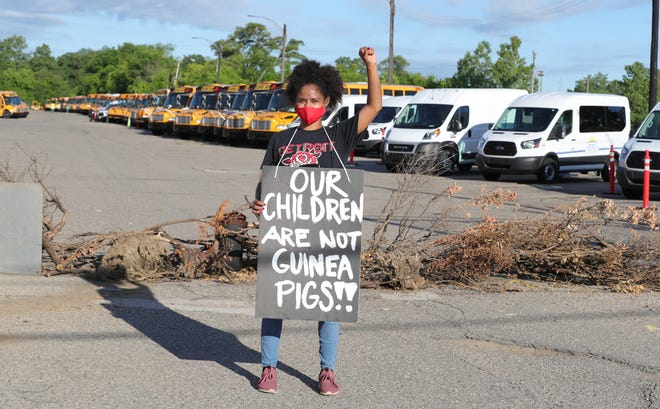 Protesters marched in front of the school bus terminal on Evergreen in Detroit on July 13, 2020. They were preventing the buses from picking up kids for voluntary summer classes held by DPS. Olivia Vaughn a parent with kids in the system came out to support the cause.
