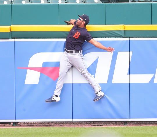 Detroit Tigers left fielder Riley Greene robs C.J. Cron of a homer by leaping over the fence to make the play during intrasquad action Monday, July 13, 2020 at Comerica Park.