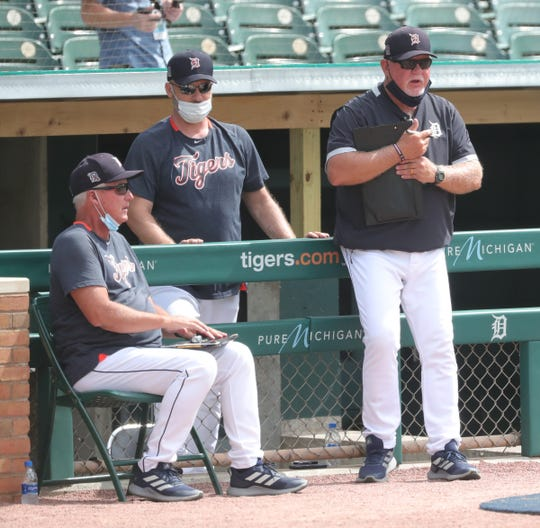 Detroit Tigers pitching coach Rick Anderson, left, coach Josh Paul, center, and manager Ron Gardenhire, right, watch intrasquad action Monday, July 13, 2020 at Comerica Park.