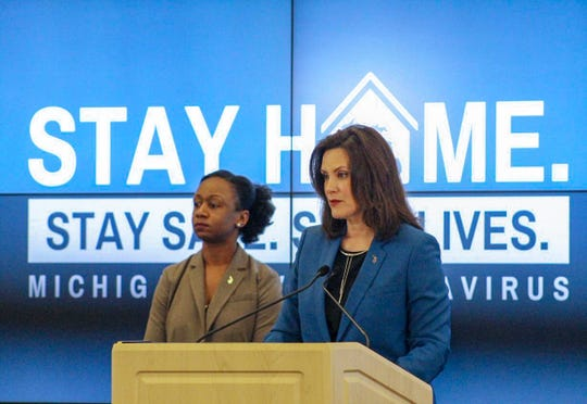 Governor Gretchen Whitmer left, and Human Services Chief Medical Executive Dr. Joneigh Khaldun, right, gives an update on COVID-19 during a press conference on April 24, 2020.