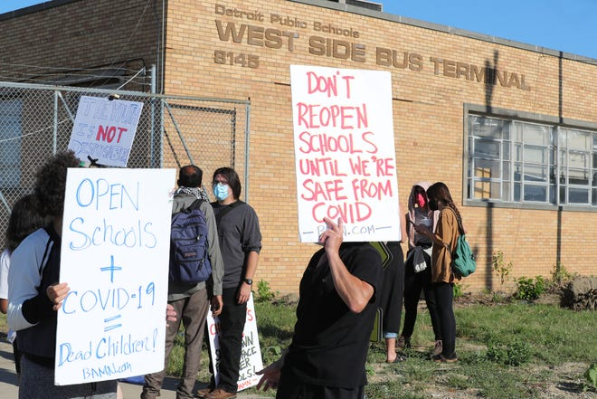 Protesters marched in front of the school bus terminal on Evergreen in Detroit on July 13, 2020. They were preventing the busses from picking up kids for voluntary summer classes held by DPS.