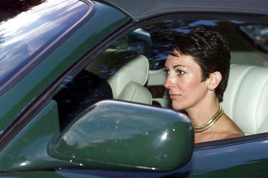 In this Sept. 2, 2000 file photo, British socialite Ghislaine Maxwell, driven by Britain's Prince Andrew leaves the wedding of a former girlfriend of the prince, Aurelia Cecil, at the Parish Church of St Michael in Compton Chamberlayne near Salisbury, England.