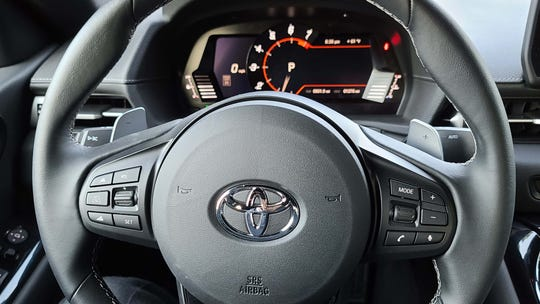The fat steering wheel of the Toyota GR Supra has all the latest gizmos like cruise control and voice recognition.