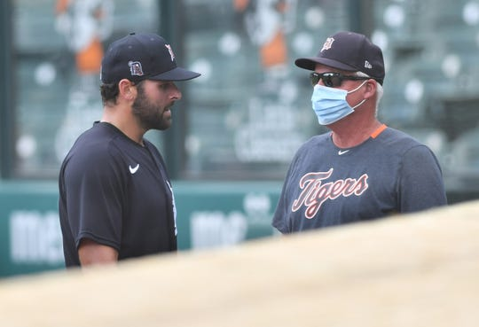 From left, Tigers pitcher Michael Fulmer talks with pitching coach Rick Anderson after Fulmer's innings during an intrasquad game at Detroit Tigers Summer Camp at Comerica Park in Detroit on July 13, 2020.
