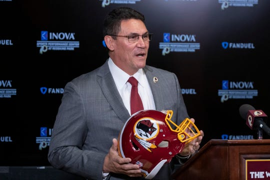 In this Jan. 2, 2020, file photo, Washington Redskins head coach Ron Rivera holds up a helmet during a news conference at the team's NFL football training facility in Ashburn, Va.