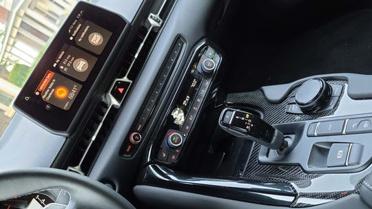 Shared with BMW and covered in carbon fiber trim, the console of the Toyota GR Supra is irresistable.