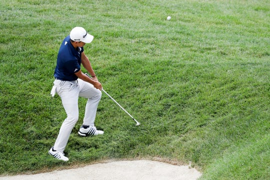 Collin Morikawa chips on the 15th hole during the final round of the Workday Charity Open at Muirfield on Sunday.