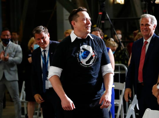 Tesla and SpaceX Chief Executive Officer Elon Musk smiles during an event at the Vehicle Assembly Building on Saturday, May 23, 2020, after a SpaceX flight at NASA's Kennedy Space Center in Cape Canaveral, Fla. A rocket ship designed and built by SpaceX lifted off with two Americans on a history-making flight to the International Space Station.