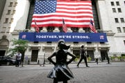 The Fearless Girl statue stands in front of the New York Stock Exchange, Thursday, July 9, 2020, in New York.