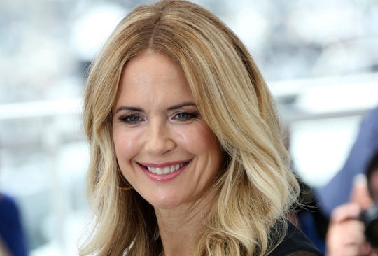 """Kelly Preston poses for photographers during a photo call for the film """"Gotti"""" in 2018 in France."""