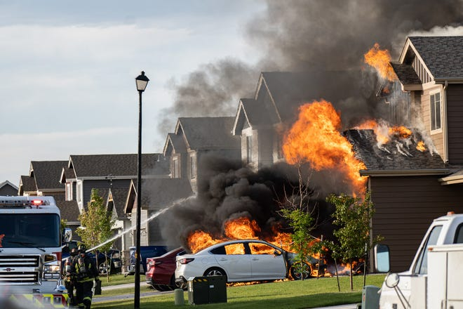 Wellington and Poudre Fire Authority firefighters responded to this house fire in Wellington on July 11, 2020. Two homes received extensive damage.
