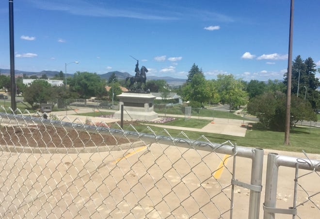 An area in front of the state Capitol has been fenced off for construction of a Tribal Flag Plaza.