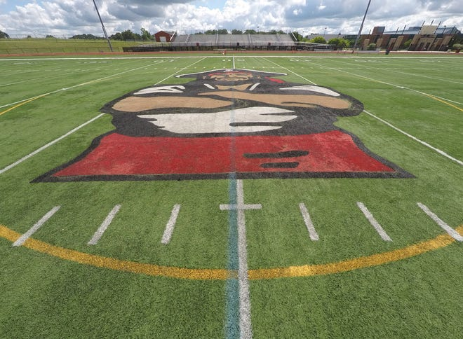 The artificial turf of Pinckney High School's stadium, shown Monday, July 13, 2020, would be resurfaced is a bond proposal on the August ballot passes.