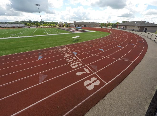 The Pinckney High School track, as well as the football field shown Monday, July 13, 2020, would be resurfaced under a bond proposal.