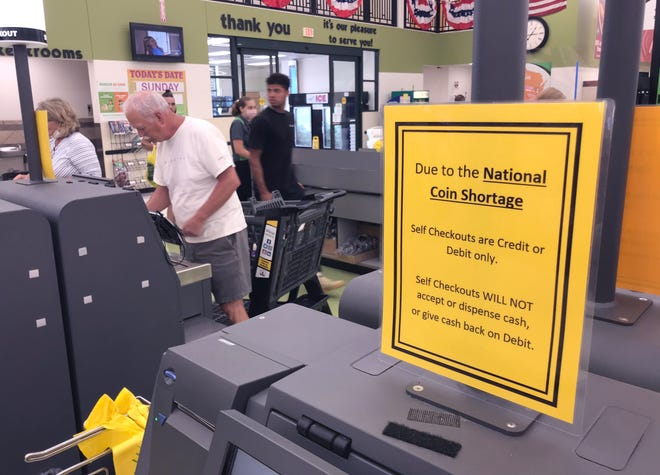 Customers use the self-check lanes at Festival Foods in Fond du Lac. There is a coin shortage in the U.S. because of the coronavirus crisis. Nationwide, there are fewer coins being spent as businesses remain closed under lockdown restrictions. Meanwhile, the U.S. Mint's production has slowed because fewer employees are working as part of ongoing social distancing measures