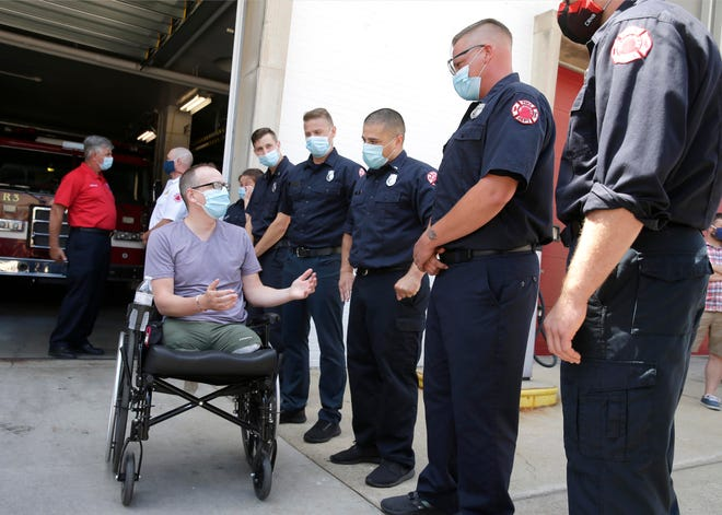 Dan Franecki, a utility worker, greets Milwaukee firefighters who saved his life after he was hit from behind by an impaired driver that caused severe damage to his legs and eventually leading to a double amputation. He thanked them for their heroic efforts.