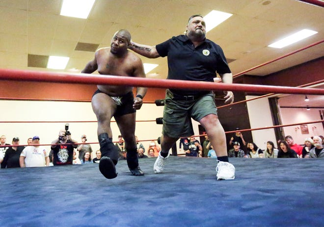 """Frankie DeFalco, left, founder of Brew City Wrestling, takes """"His Holiness"""" Shawn Priest to the ropes during a bout at a 2015 show at the Elks Lodge in Waukesha. Brew City has drawn criticism for scheduling an in-person wrestling event for July 18."""