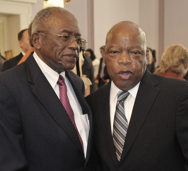 Fred Gray, left, and U. S. Rep. John Lewis talk after the 2011 Alabama Academy of Honor ceremonies in the old House chamber of the Alabama Capitol on Monday, Oct. 17, 2011, in downtown Montgomery, Ala.. (Montgomery Advertiser, Lloyd Gallman)