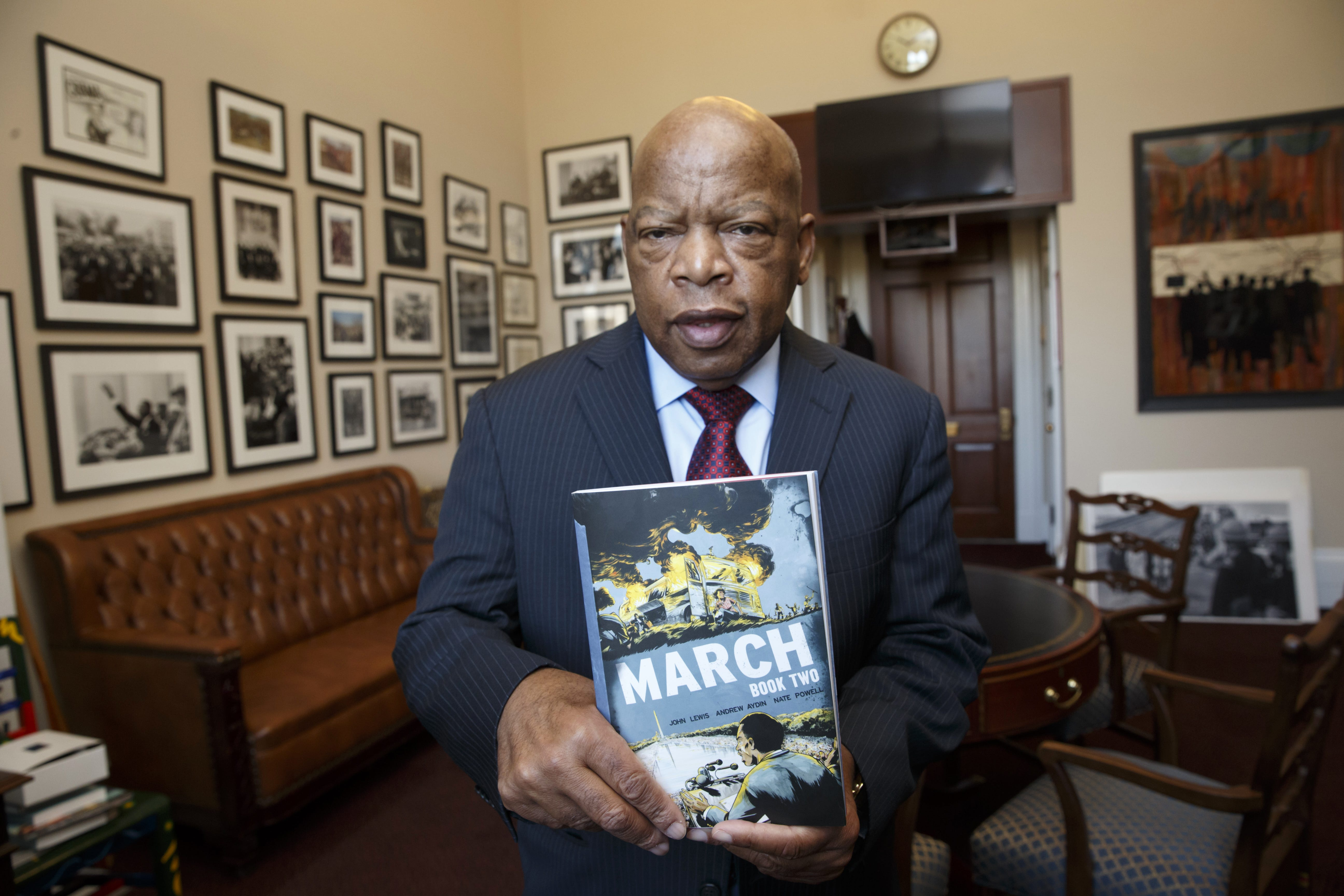 U.S. Rep. John Lewis holds the new installment of his award-winning graphic novel. A comic book about Martin Luther King Jr. helped bring Lewis, one of the leaders of the Selma-to-Montgomery march on Bloody Sunday, into the civil rights movement.