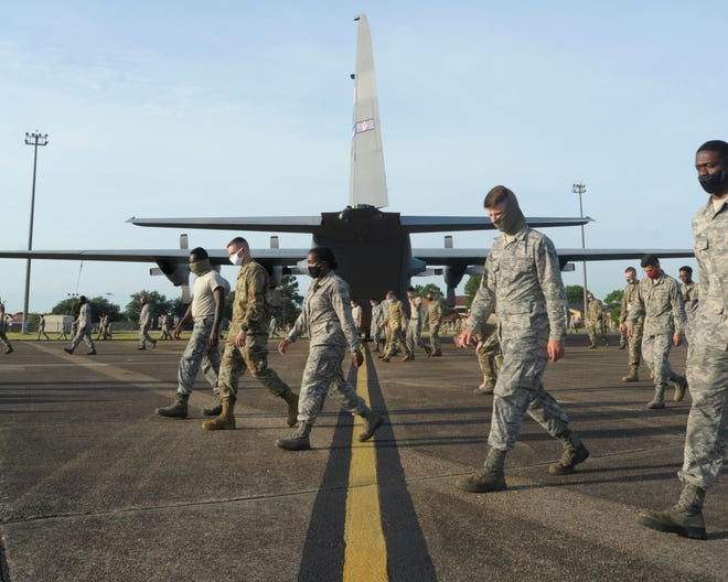 Airmen all across the 908th Airlift Wing congregated for a Foreign Object and Debris walk the morning of July 12, on the flight line at Maxwell Air Force Base, Alabama. It is necessary for FOD walks to be performed so that any loose metal objects, rocks or other materials can be recovered so as to not harm any of the aircraft.