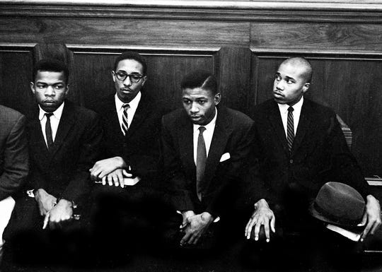 Participation in Nashville, Tennessee's lunch counter demonstrations landed John Lewis, left, Bernard LaFayette, second from left, and Paul Brooks, far right, in court on Nov. 21, 1960.