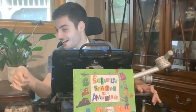 Jason Turner shares his love of reading with others through his Youtube channel from his Alexandria home.