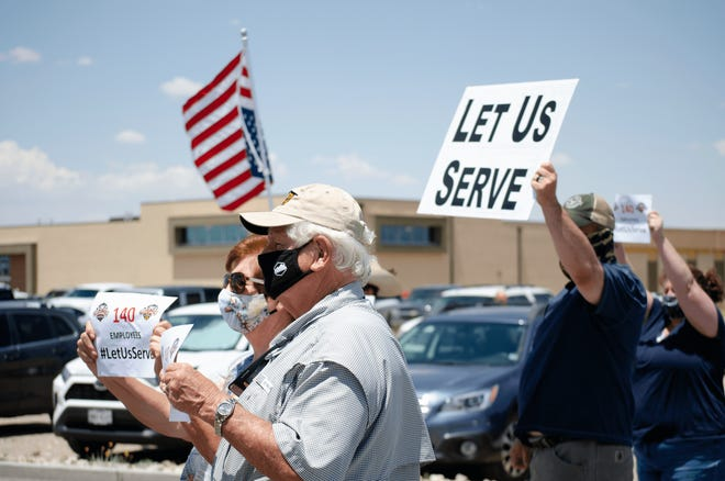 Protesters gather in front of The Game II Monday afternoon, July 13, to protest the restriction of indoor dining at New Mexico restaurants due to the latest COVID-19 health order.