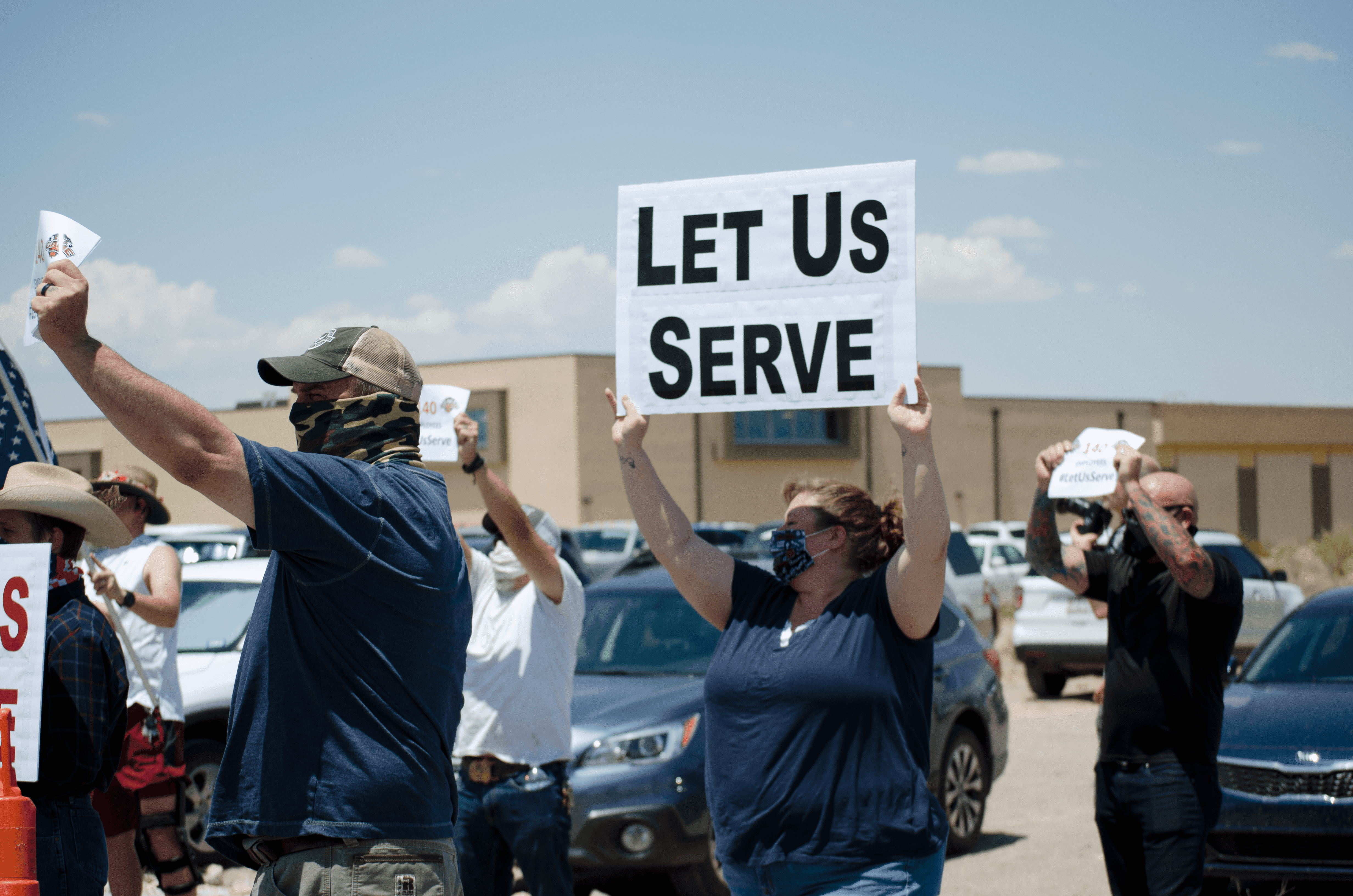 Protesters gather in front of The Game II restaurant in Las Cruces on Monday, July 13, 2020, to protest the restriction of indoor dining at New Mexico restaurants due to the latest COVID-19 health order.