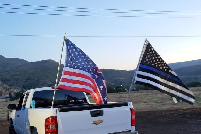 """During the July 4th Weekend the Ruidoso Downs requested these flags to be removed from Mike Curtis' truck while he was on the Downs' property, working at as an EMT. The left flag, a half Confederate/half United States flag, and on the right a """"Thin Blue Line"""" flag to honor police."""