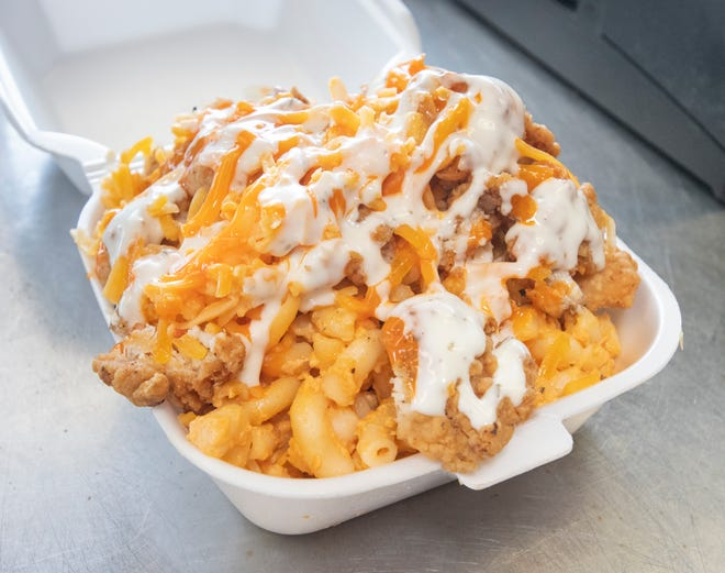 An order of buffalo chicken mac is ready to eat in July at the new Melt food truck in Pensacola.