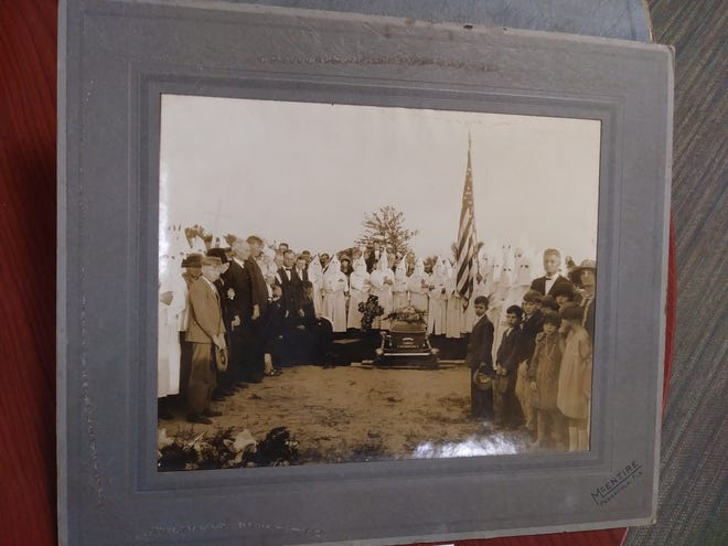 A photograph from Wentworth's collection of KKK members at an unidentified funeral. The document is part of T.T. Wentworth Jr.'s personal collection archived in the Hilton-Green Research Room of the University of West Florida Historic Trust.