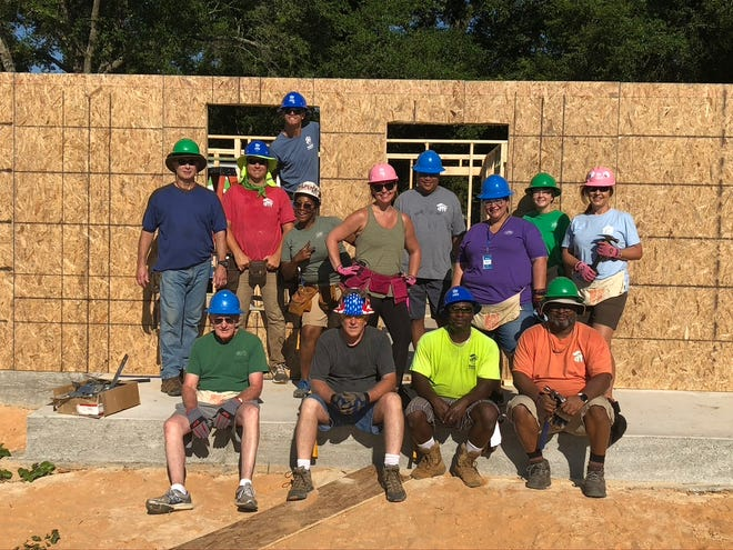 Pensacola Habitat for Humanity staff and board members build 1400th home.