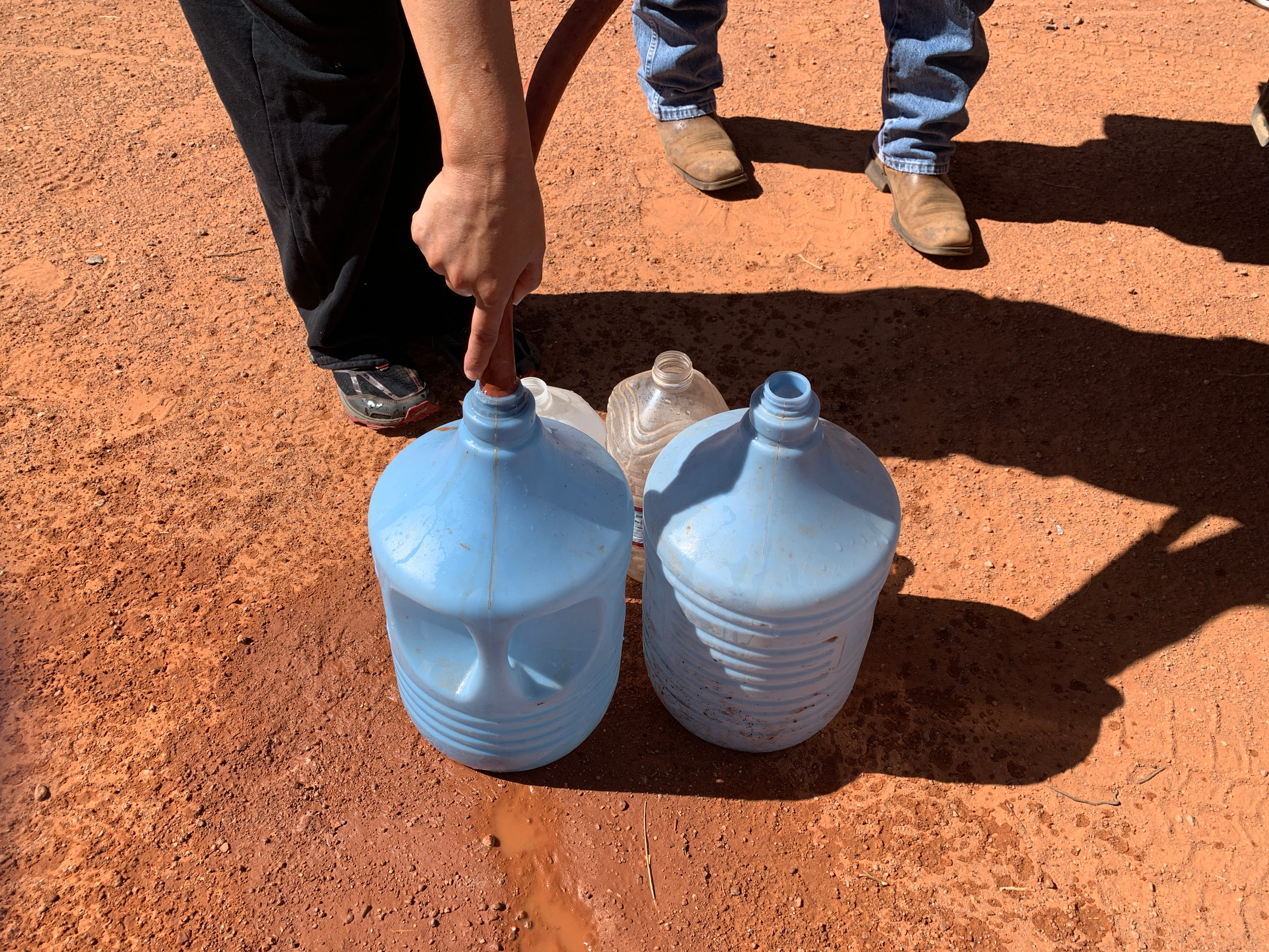 Larry Holiday delivers water by truck to a man whose home doesn't have running water in Monument Valley on the Navajo Nation.