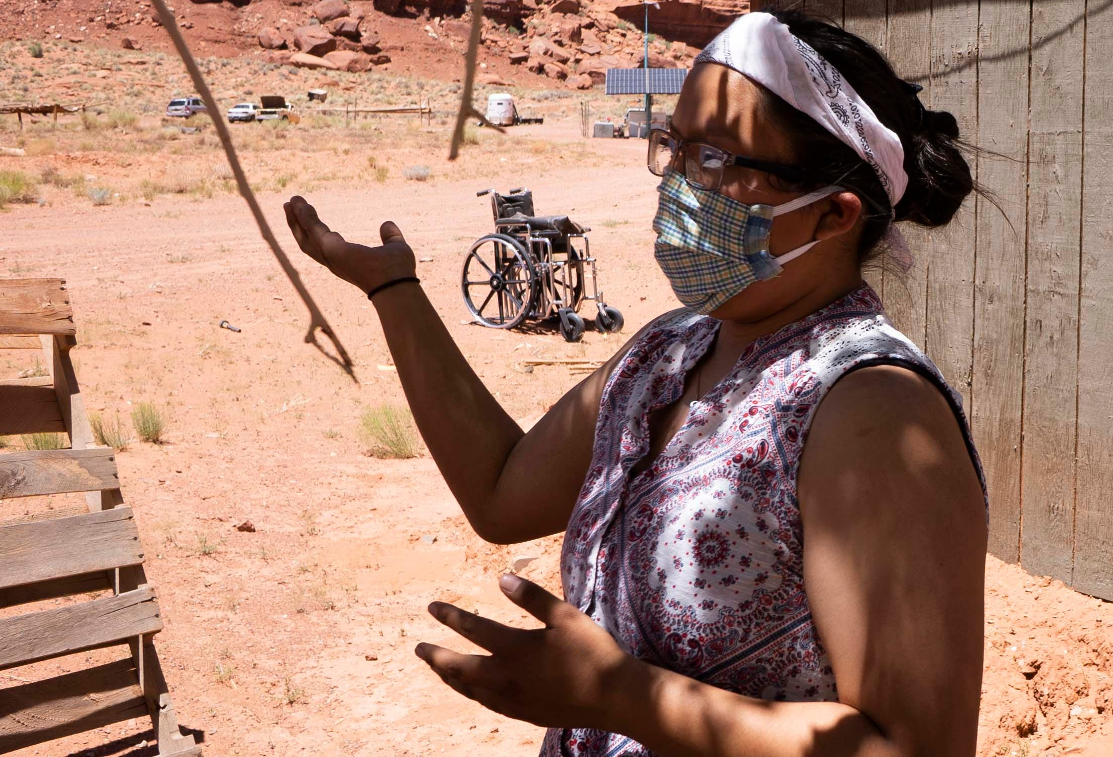 Felicia Holliday, 17, speaks about how her family gets water to their home in Monument Valley, just south of the Utah-Arizona border, on the Navajo Nation. She says she bathes her grandmother with a bucket and a washcloth. Other relatives keep the water barrels filled by making trips to a spigot to fill up.