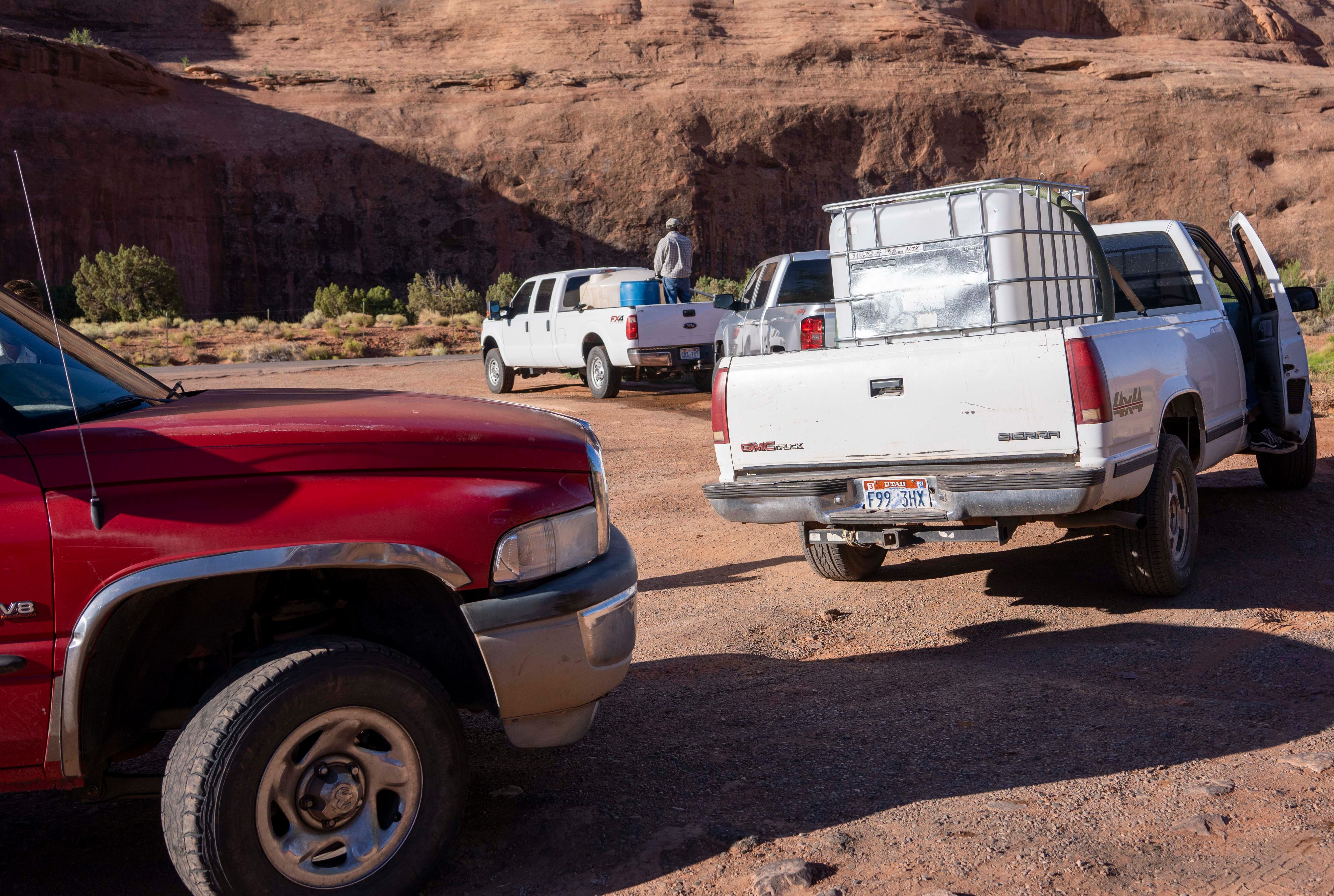People line up for water at a spigot in the community of Goulding, Utah, waiting for about an hour. Many families in this part of the Navajo Nation live in homes without running water.
