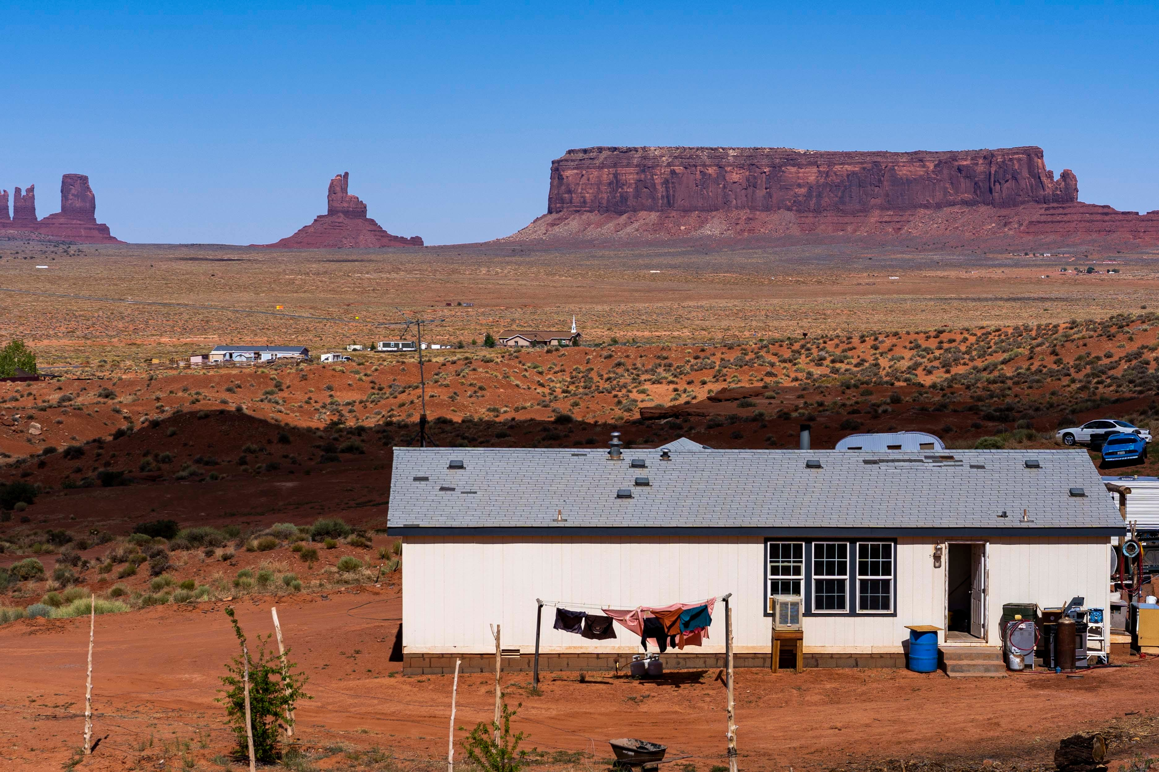 Residents dry their clothes outside a home in Monument Valley, Utah. An estimated 30% percent of people across the Navajo Nation live in homes without running water.