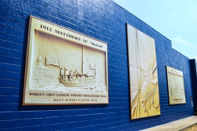 Jerry Davenport's relief carvings in the banners feature two vintage Matthews boats and a view from a sailboat.