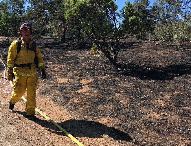 A fire scorched 2 acres off Peppertree Lane in Redding on Sunday.