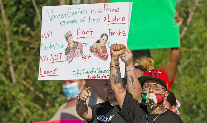 Demonstrators protest across from Goodfellow AFB on Sunday, July 12, 2020 against what they say is inaction on the part of the military in investigating the death of Vanessa Guillen.