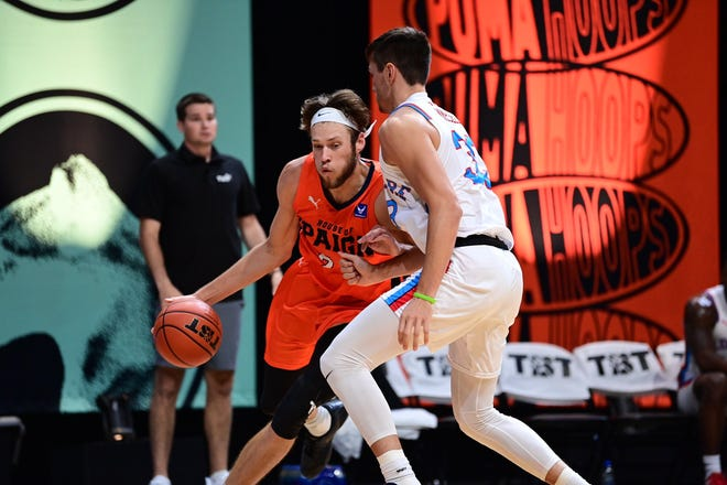 Mike Daum dribbles toward the basket for House of Paign in The Basketball Tournament