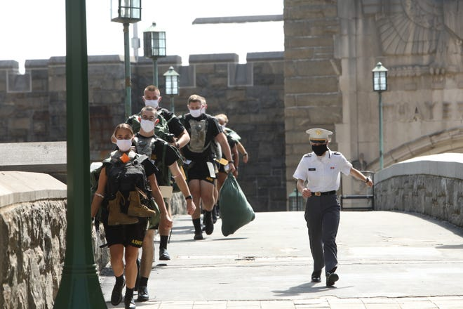 A cadet leads a line of new cadets during basic training at the U.S. Military Academy at West Point July 13, 2020 in  in West Point, N.Y. The 1,200-member class has been brought to campus in three separate reception days to accommodate public health guidelines. Candidates are COVID-19 tested immediately upon arrival, wear facial coverings and practice social distancing.