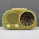 This plastic Fada radio was made about 1941. It is alabaster color and about 6 by 10 by 6 inches. Now faded to a light green, it sold for $1,000.