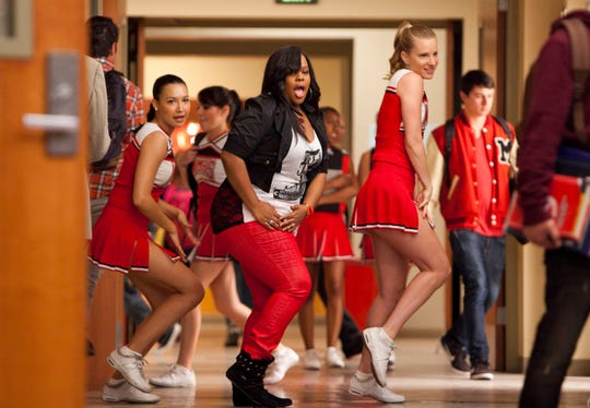 "Santana (Naya Rivera, left), Mercedes (Amber Riley, center) and Brittany (Heather Morris) perform in the 'Saturday Night Glee-ver' episode of ""Glee."""