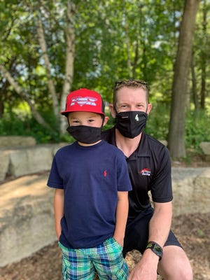 NTT IndyCar Series driver Charlie Kimball of A.J. Foyt Racing poses with Parker Marcase, 7, of Pineville last Friday in Wisconsin. Both are Type 1 diabetics. Kimball, whose sponsor is insulin maker Novo Nordisk, enjoys meeting children with diabetes to provide hope and inspiration.