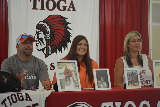 Tioga catcher Chloe French (center) signed with Louisiana College Monday. From left are father Billy French, Chloe and stepmother Erica Ivy.