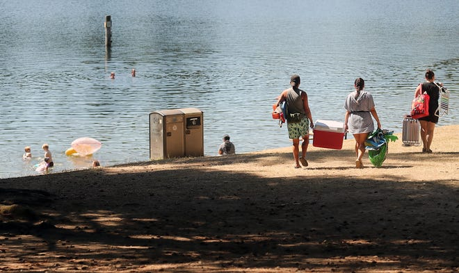 FILE — People head for the beach at Wildcat Lake Park in July 2020.